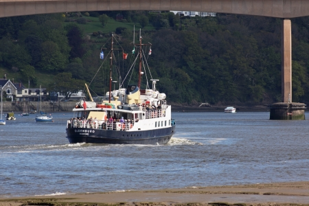 bristol channel: Bideford, England May 12 - The MV Oldenburg makes its way up the Torridge estuary on a rising tide taking day-trippers to Lundy Island in the Bristol Channel