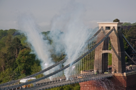 Bristol, England May 23, 2012 - Accompanied by fireworks the Olympic flame crosses Brunel's historic Clifton suspension bridge UK Stock Photo - 13887218