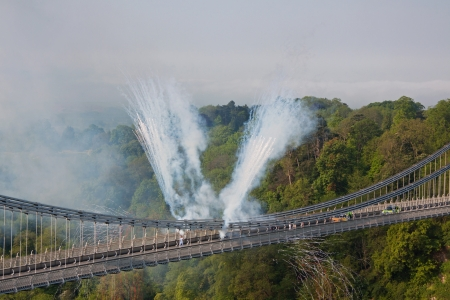 Bristol, England May 23, 2012 - Accompanied by fireworks the Olympic flame crosses Brunels historic Clifton suspension bridge UK