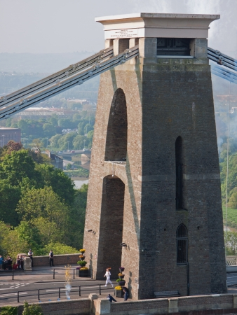 Bristol, England May 23, 2012 - Torchbearer carrying the Olympic flame emerges on the Bristol side of Brunels historic Clifton suspension bridge UK