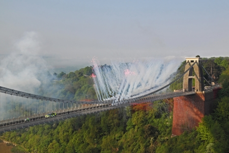 Bristol, England May 23, 2012 - Fireworks mark the passing of the Olympic flame across Brunel's historic Clifton suspension bridge UK Stock Photo - 13887157