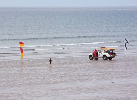 Westward Ho, England � May 28, 2012 - Lifeguard patrol on the beach between safety flags at Westward Ho