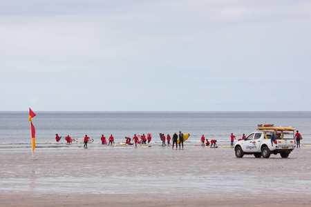 Westward Ho, England � May 28, 2012 - Beginners take to the water under the supervision of instructors and lifeguards for a surfing lesson at Westward Ho