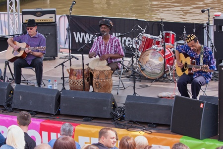 gig harbor: Bristol, England - July 21, 2012 - The Afrikan Blues Connection play the Cascade Steps stage at the annual Harbour Festival, attended by a record 300,000 people over three days