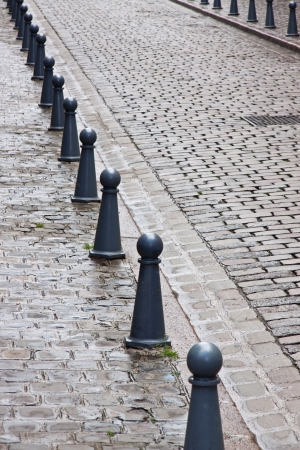 Bollards line a cobblestoned street in the old part of Lille, France photo