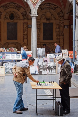 Lille, France 13th July, 2012 - Chess players in the Renaissance marketplace (Vieille Bourse) in old Lille, once central to the local economy and now home to booksellers and chess players