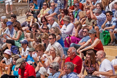 shirtsleeves: Bristol, England - July 22, 2012 -  An audience basks in the sun at the 41st Bristol Harbour Festival attended by 300,000 people over three days Editorial