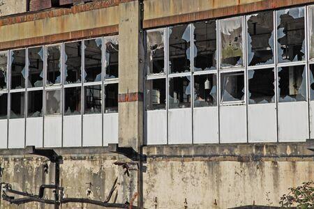 decrepitude: Broken windows in an abandoned industrial premises UK