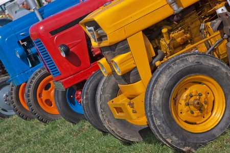 Vintage tractors lined up at an English country fair photo