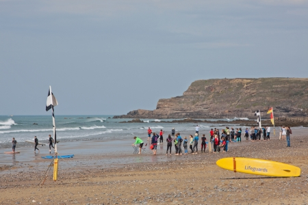Widemouth Bay, England - September 27, 2013 - Surf school monitored by lifeguard