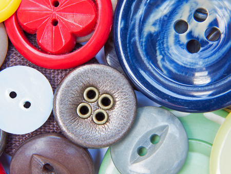 zip tie: Cose up view of colourful dress buttons