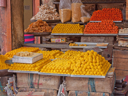 sweetmeats: Sweetmeats for sale displayed on a stall in Japiur, India Editorial