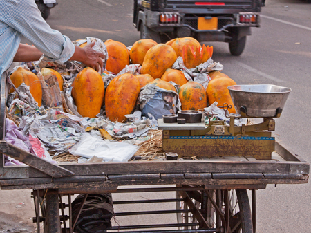 invigorate: Mango seller cart parked at a roadside in Jaipur, Rajasthan