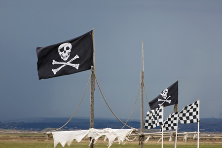 privateer: Piratical skull and crossbones flags Stock Photo