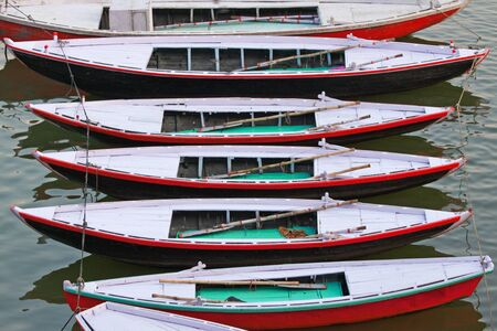 afloat: Pleasure boats for hire on the River Ganges at Varanasi, India Stock Photo