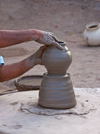 operative: A village potter in Rajasthan creating a new vessel using traditional techniques Stock Photo