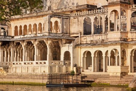 providing: Ancient ghat providing access to Lake Pichhola at Udaipur India Stock Photo