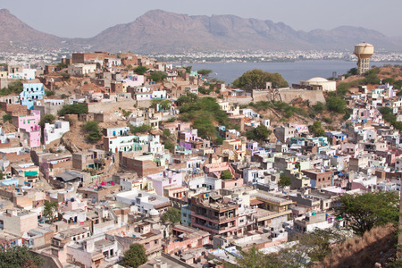 sufi: View of the town of Ajmer in Rajasthan India with the Aravalli hills and the large artificial lake Anasagar. It is a pilgrimage centre for the shrine of the Sufi Saint Khwaja Moinuddin Chishti
