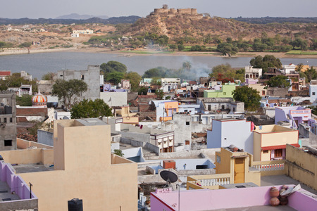 citizenry: Typical Rajasthani urban housing ar Deogar with the ancient fort and Raghosagar Lake in the background
