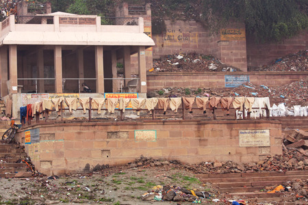personal service: Laundry drying on a railing on the banks of the river Ganges at Varanasi India left there by Dhobis who wash clothes in the river for a livelihood Editorial