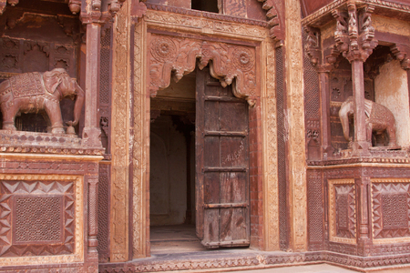 rajput: An ornate doorway part of the 16th century Jehangir palace and temple complex at Orchha India built in the 16th century and capital of the ancient Rajput kingdom