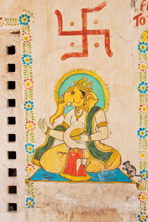 graffito: Udaipur, INDIA - March 5, 2015: Wall art in the city , displaying a swastka and elephant god with the characteristic level of detail of the genre in Rajasthan