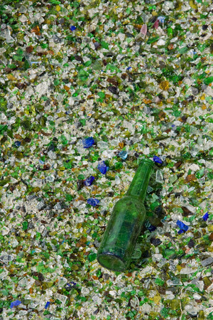 reclamation: Discarded beer bottle on a bed of glass particles at a recycling centre Stock Photo