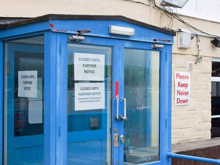 slump: Signs on an empty entertainmet business premises