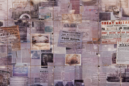 documenting: BRISTOL, UK - JANUARY 7, 2012: Old newsprint montage displayed near the entrance to the city docks documenting dockland developments and other local matters at the end of the nineteenth century Editorial
