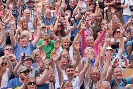 BRISTOL, UK, 21st July, 2012.: A happy audience shows its appreciation for an act at the 41st Bristol Harbour Festival. The return of summer weather prompted large crowds to attend the largest event of its kind in Europe Editorial