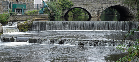 downstream: Weir on the river Tavy near Tavistock in Devon, England Stock Photo