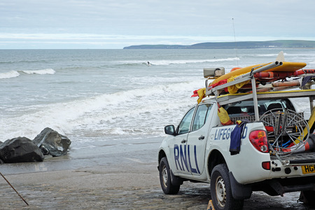 WESTWARD HO!, ENGLAND – SEPTEMBER 20, 2016: Surfers off the Devon coast are protected by the Royal National Lifeboat Institution, a 190 years old charity Editorial