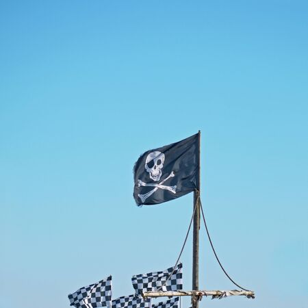 The pirates flag, the Jolly Roger, flying high Stock Photo