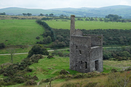 the eighteenth: Remains of the engine house of a derelict eighteenth century tin mine on the edge of Dartmoor