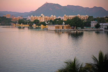 Udaipur at dusk in early winter. It is situated on Lake Pichola and surrounded by the Aravalli Hills