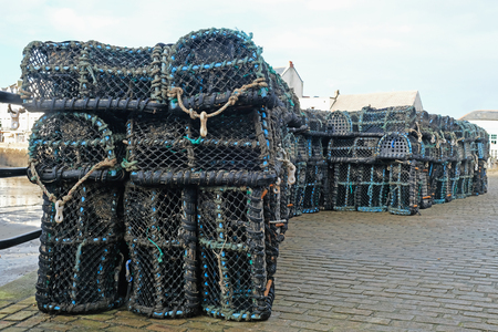 Lobster creels stacked on an English quayside Stock Photo
