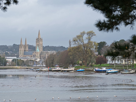 The cathedral and riverside moorings in Truro city with the river tide ebbing. Truro is the UKs most southerly city