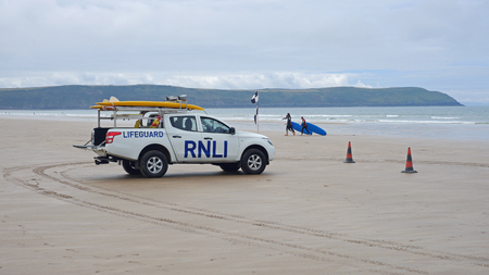 NORTH DEVON, ENGLAND - JULY 7, 2017: Surfers and swimmers off the Devon coast are protected by the Royal National Lifeboat Institution, a 190 years old charity