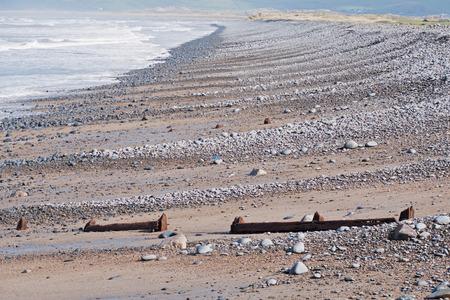 Beach strewn with pebbles on the North Devon coast