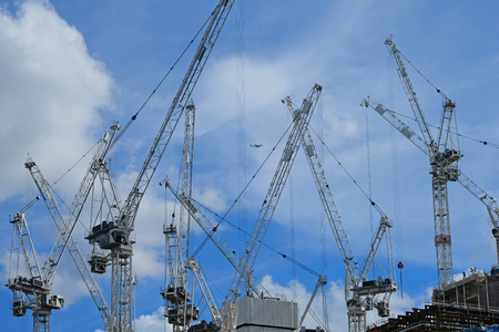 Tower cranes on a UK construction site Stock Photo
