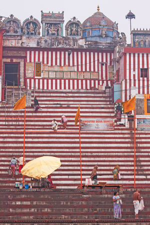 Varanasi, India – March 3, 2015: Pilgrims in the early morning at Vijayanagaram Ghat. Devout Hindus travel from across the world to ritually cleanse themselves of sin in the sacred waters of the river Ganges