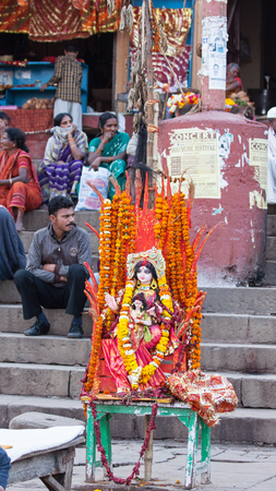 VARANASI, INDIA – MARCH 3, 2015: A temporary shrine to the demoness Holika on the shores of the Ganges. Holika, and her charge Prahlad, are burnt on bonfires by Hindus in their annual celebrations on the eve of the Holi festival