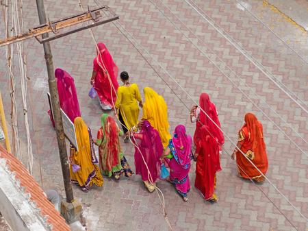 A group of Hindu pilgrims visiting the Meenakshi temple complex in Madurai in Tamil Nadu Stock Photo