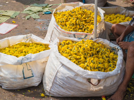 Marigold flower heads for sale at a market in Tamil Nadu state, India Stock Photo