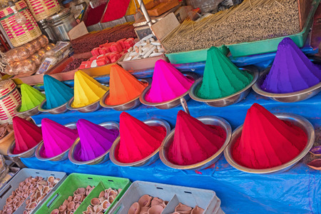 Rangoli powder, incense and joss sticks on display in an Indian market. The colourants usually have a turmeric base and are used in Hindu forehead marking and for festivals Stock Photo