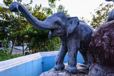 relies: Ancient elephant statue in Prommanusorn School, Petchaburi, Thailand  Stock Photo