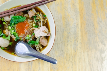 Thai Noodle Soup with Meat on wooden table photo