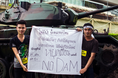 environmentalists: BANGKOK - Sep 22  Protesters hold an anti-Mae Wong Dam rally on September 22,2013 in Bangkok, Thailand  The protesters known as Stop EHIA Mae wong Dam by walking 388 Km  from Mae wong to Bangkok