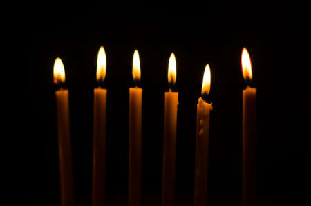 candle against black background photo