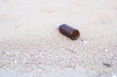 used bottle on the tropical sea beach  photo